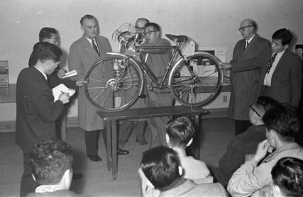 Art Center representatives examining a bicycle during a presentation in Nagoya, 1956, (2004.83.185.10). Photographer unknown. Gift of Carson Pritchard.