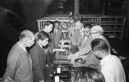 Art Center representatives touring the Juki Sewing Machine company factory floor in Tokyo, 1956, (2004.83.6.2). Photographer unknown. Gift of Carson Pritchard.