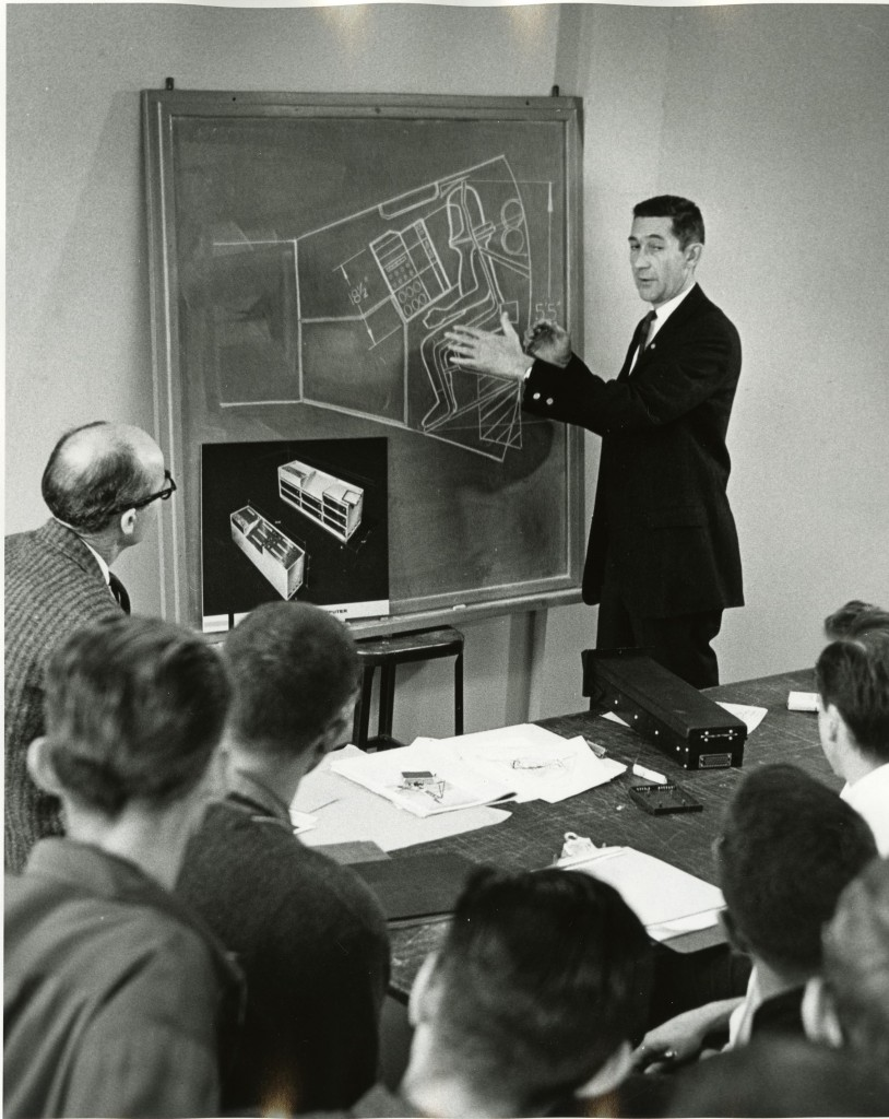 George Beck, of General Electric, giving GE Space Capsule Project assignment to students, 1960. (2004.22.2200.W). Photography by Geoffrey Fulton. Art Center College of Design.