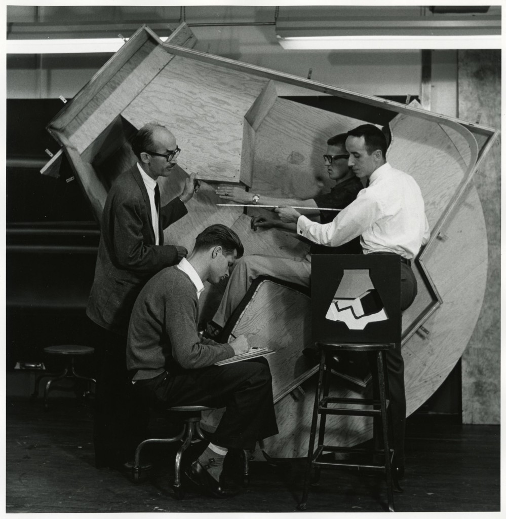 Instructor John Coleman advising students as they work on the wooden framework for the General Electric Space Capsule Project, 1960. (2004.22.2202.E).  Photography by Geoffrey Fulton. Art Center College of Design.