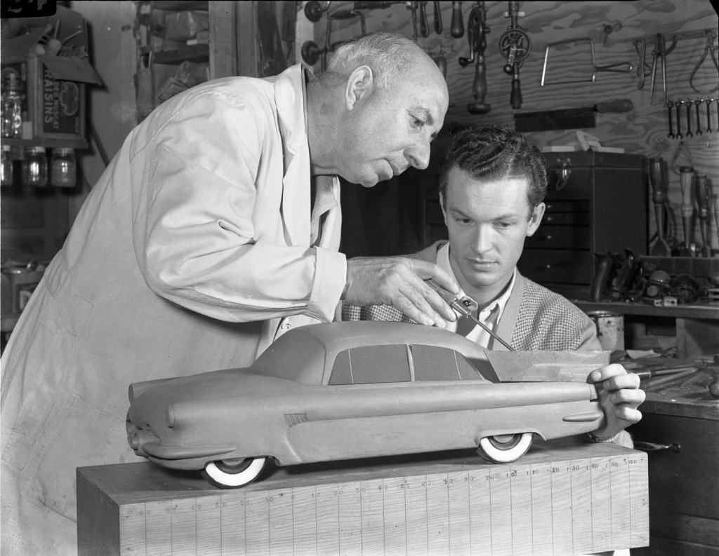 Joseph Thompson advising Robert Bartholomew (PROD 1950) as Robert works on a clay model of a car, circa 1949. Art Center College of Design.