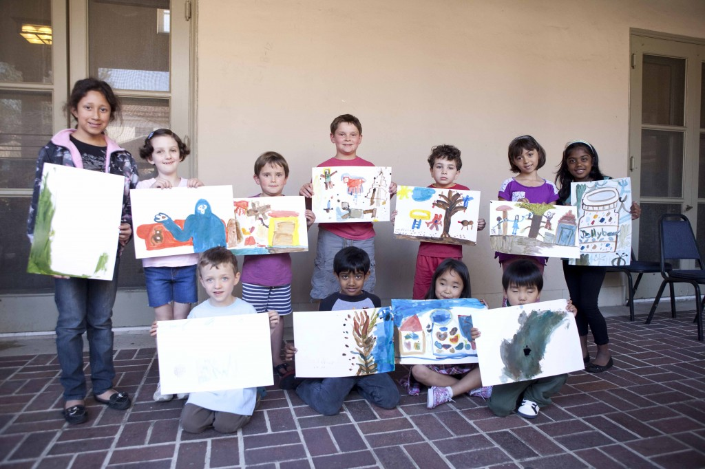 "At Pasadena Public Library, participants in ""Uncool"" children's art workshop show off their paintings. Photo by Alex Aristei."