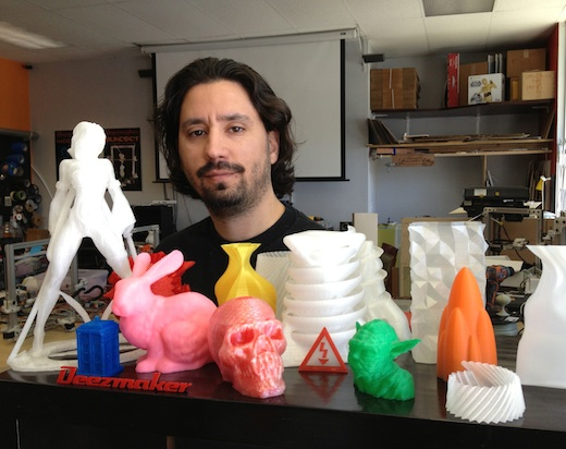Diego Porqueras, along with Bukobot-printed 3D objects, at his Deezmaker store in Pasadena.