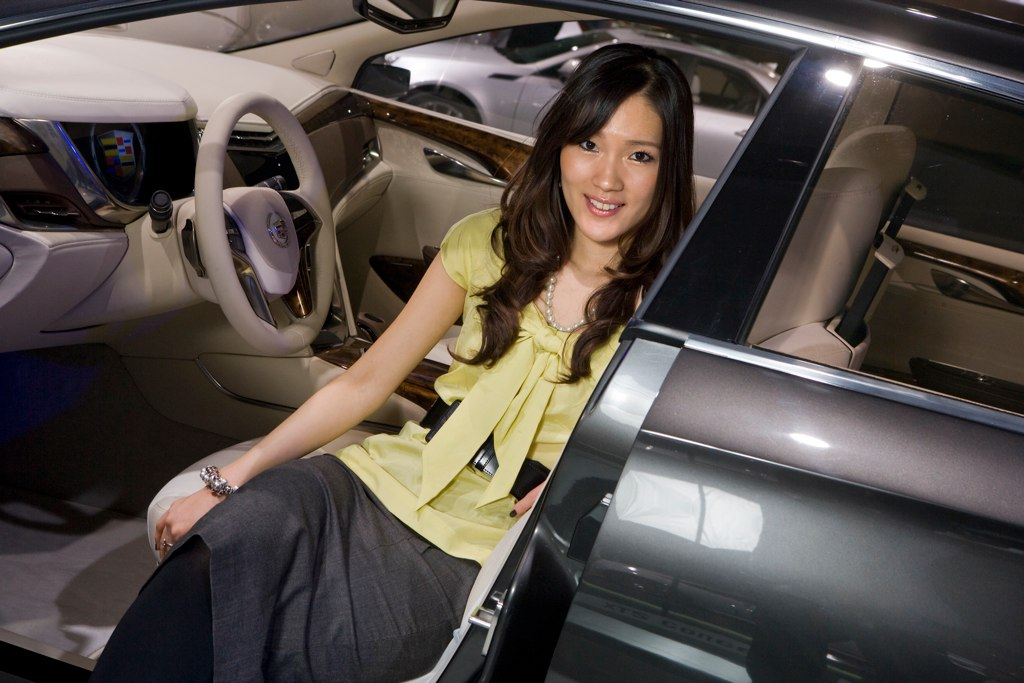Alumna Christine Park of General Motors Design with the Cadillac XTS Platinum concept vehicle. Photo by John F. Martin for Cadillac.