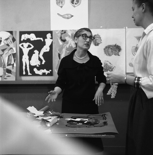 Instructor Mary Vartikian standing in front of the crit wall with an unidentified female student, circa 1959.  Photographer unknown.