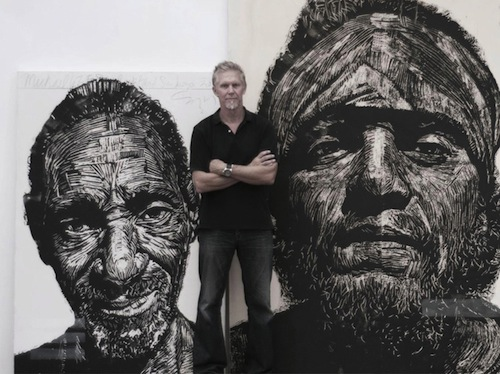 Illustration alum, Neil Shigley with block prints including, at left, Michael 67 (Pastor Shelby).