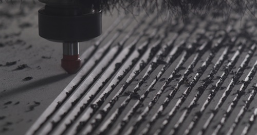 The CNC machine creates 3-D objects from digital files