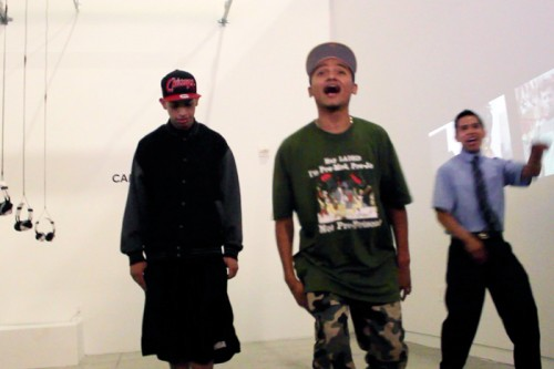 "Performing their song, ""The Road I Walk,"" at the gallery are from left, Marlon ""Mr. Stranger,"" Kevin ""Lil' Krazy aka Ghetto Boy"" and Lorenzo ""Mr. L.A."""