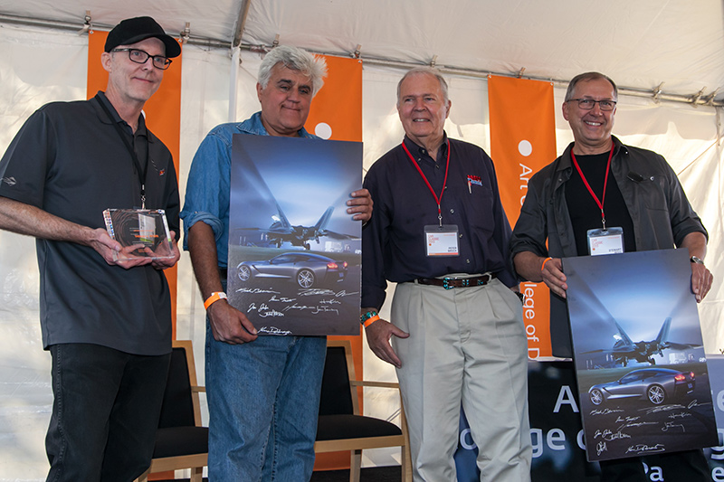 Tom Peters presents poster to Stewart Reed and Jay Leno with Peter Brock