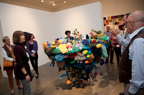 Alum Lynne Aldrich leads a tour of her sculpture exhibit in the Williamson Gallery