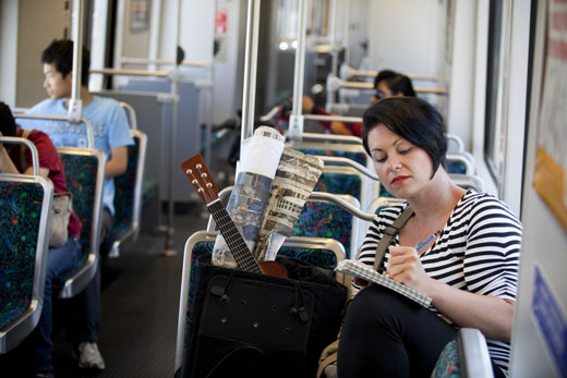 Fine Art student Kristy Lovich on board the Metro. Photo by Jennie Warren.