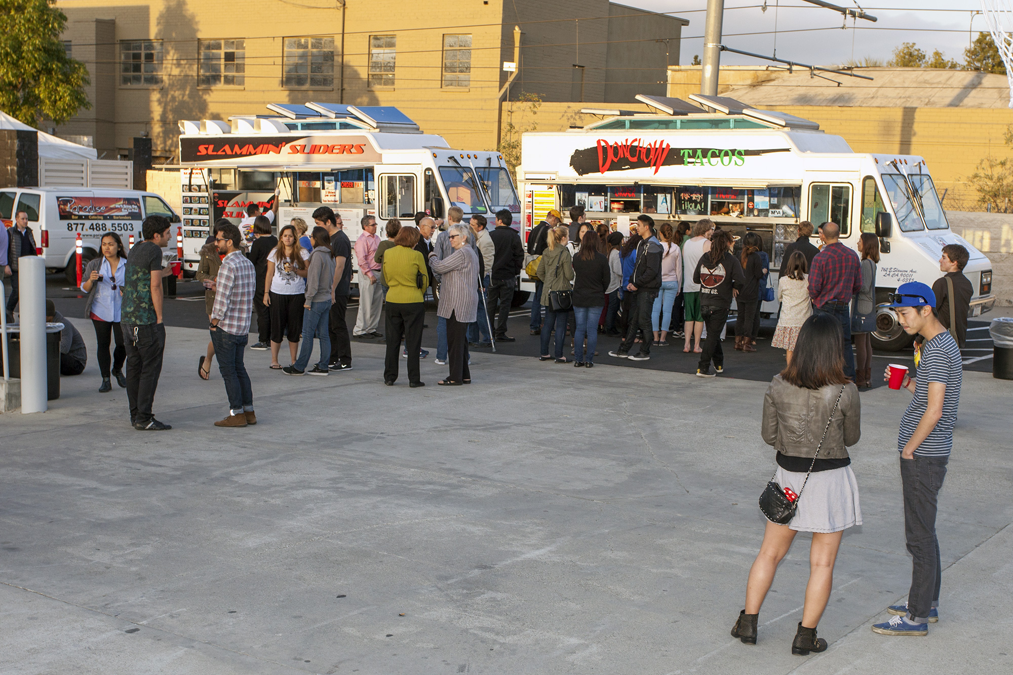 Students, faculty and staff  enjoying the food trucks at the opening party at 870