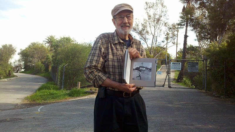 Holding his book Chavez Ravine: 1949, Don Normark revisits some of the sites that he photographed more than a half a century earlier. (Photo by Jaime Zacarias)