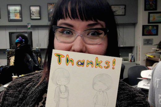 Illustration student Ashley Pinnick shows off some appreciation by Blair High School's Art Club.