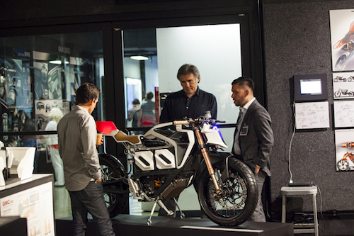 Bruno Gallardo shows off his Zero Motorcycle prototype to alum Miguel Galluzzi of Aprilia/Piaggio. Photo by Jennie Warren