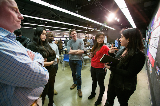Students Angela Dong, Thokozani Mabena,Vivia Liu and Sarineh Issagholian discuss their concepts with Jaguar Land Rover representatives at the New Car Experiences midterm. Photo: Chris Hatcher
