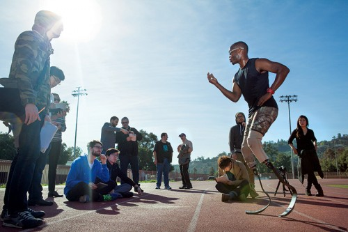 Brazil 2016 Olympic hopeful Blake Leeper demonstrates running blades for students and collaborators from global chemical company Eastman and Altair Engineering to improve existing inferior technology. Photo by Stella Kalinina (BFA 13).