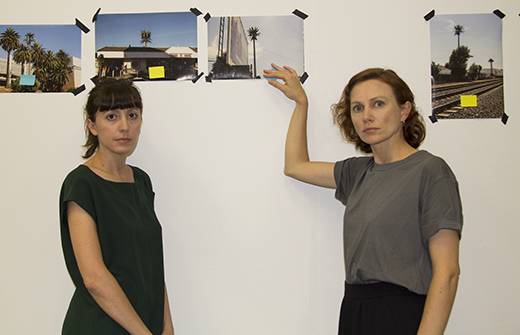 Asli Serbest (left) and Mona Mahall selecting images of artificial palm trees for the Natural Wifi installation in Media Design Practices' Wind Tunnel Gallery at ArtCenter's South Campus. Photo: m-a-u-s-e-r