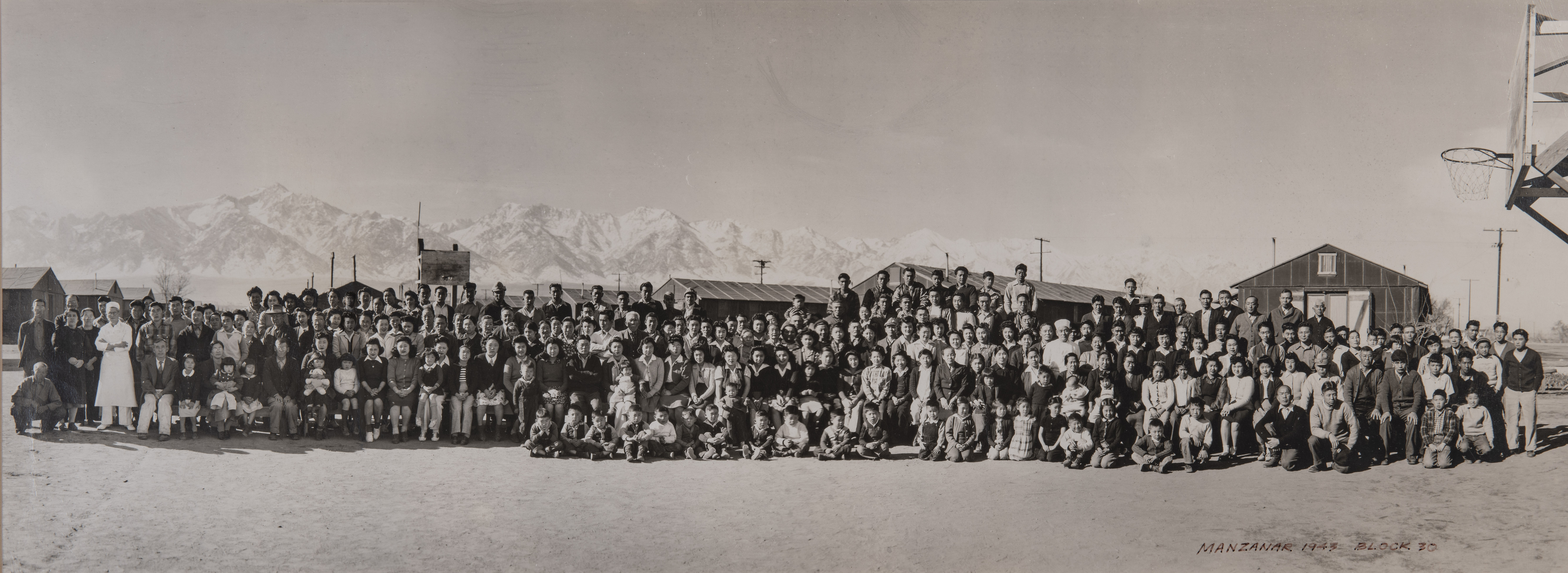 Group photo from Manzanar War Relocation Center.  Young Matsumoto is almost dead center with his family behind him. Photo courtesy Bob Matsumoto.