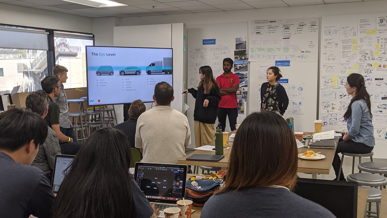 ArtCenter students presenting their midterms to Waymo's Head of Design, YJ Ahn. Image courtesy of Waymo